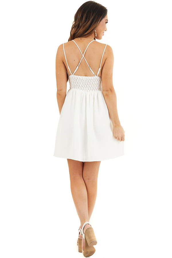 White Lace Mini Dress with Criss Cross Straps and Pockets back full body