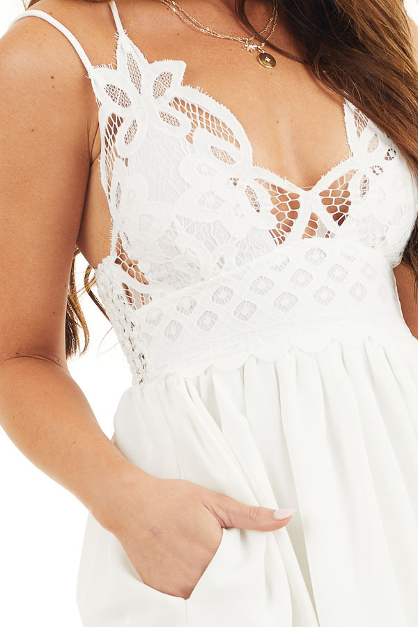 White Lace Mini Dress with Criss Cross Straps and Pockets detail