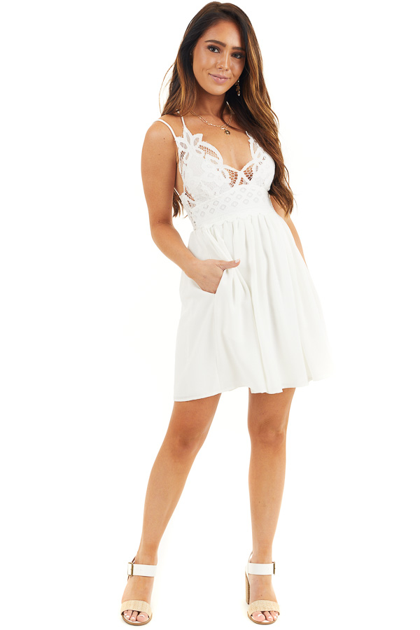 White Lace Mini Dress with Criss Cross Straps and Pockets front full body