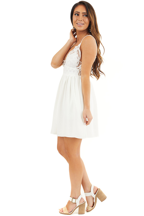 White Lace Mini Dress with Criss Cross Straps and Pockets side full body