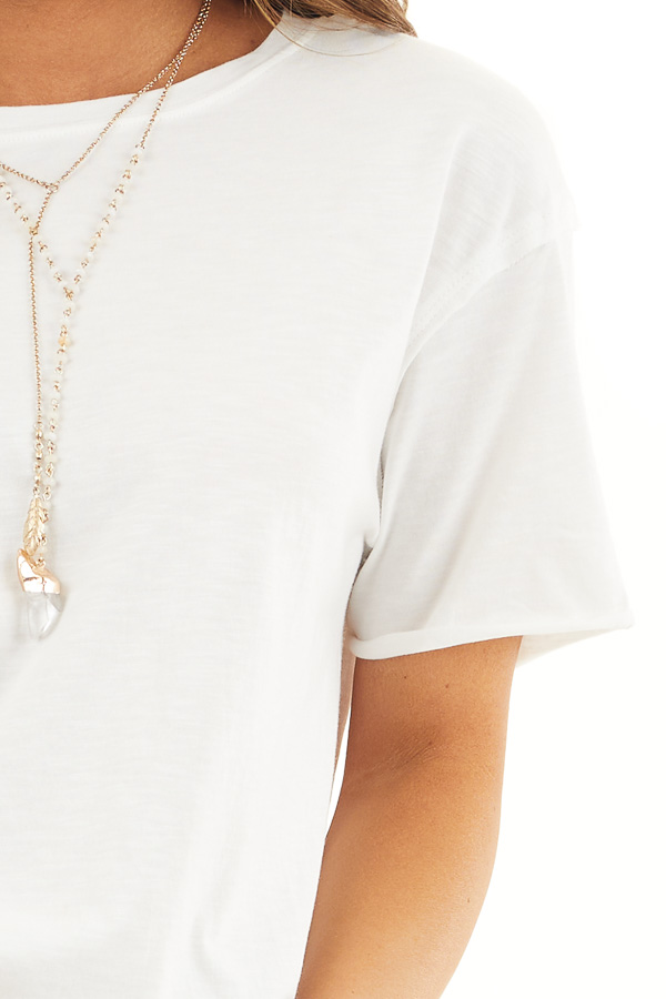 Off White Short Sleeve Knit Top with Raw Edge Details detail