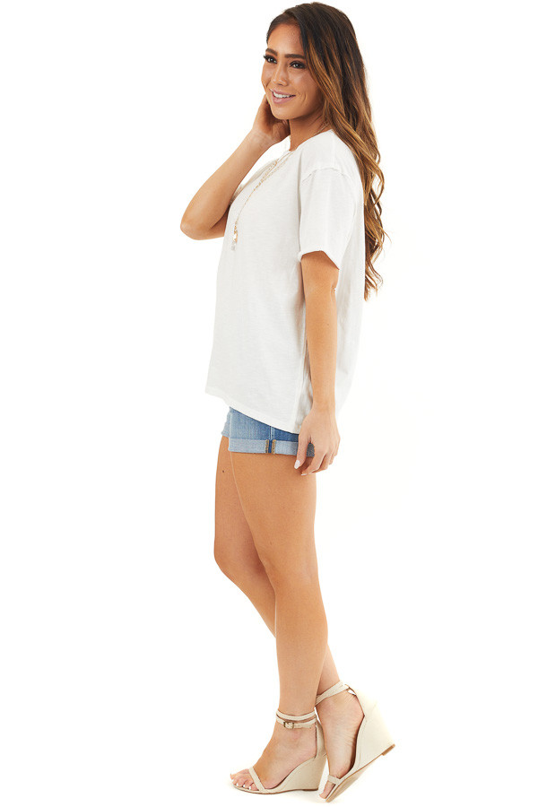 Off White Short Sleeve Knit Top with Raw Edge Details side full body