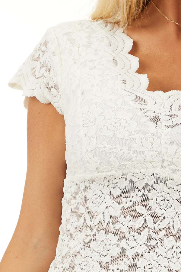 Off White Lace Short Sleeve Woven Top with Scalloped Hemline detail
