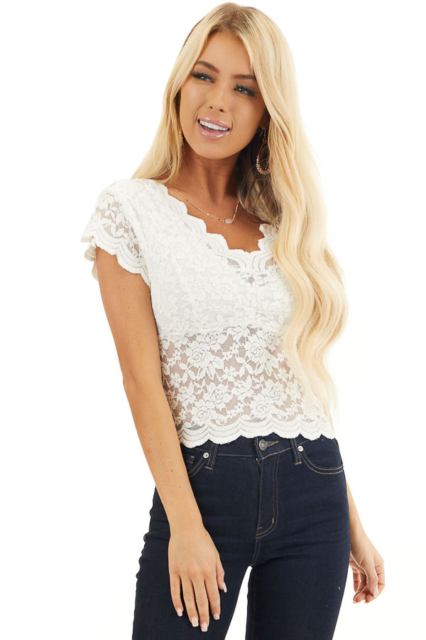 Off White Lace Short Sleeve Woven Top with Scalloped Hemline front close up