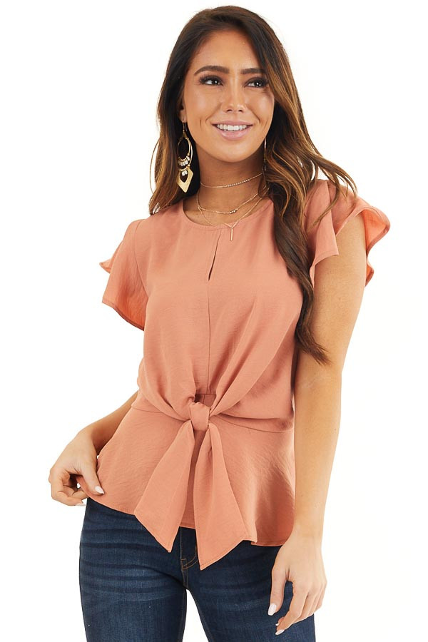Faded Terracotta Peplum Blouse with Front Tie Detail front close up