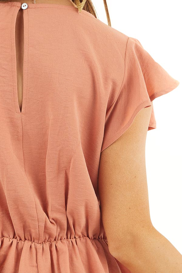 Faded Terracotta Peplum Blouse with Front Tie Detail detail