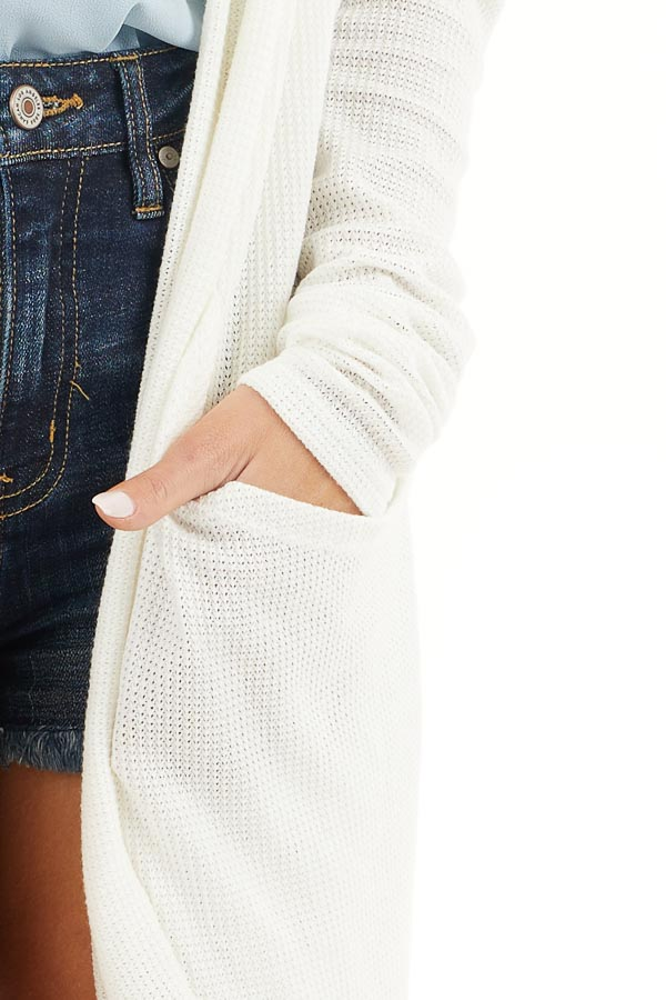 Off White Textured Knit Long Sleeve Cardigan with Pockets detail