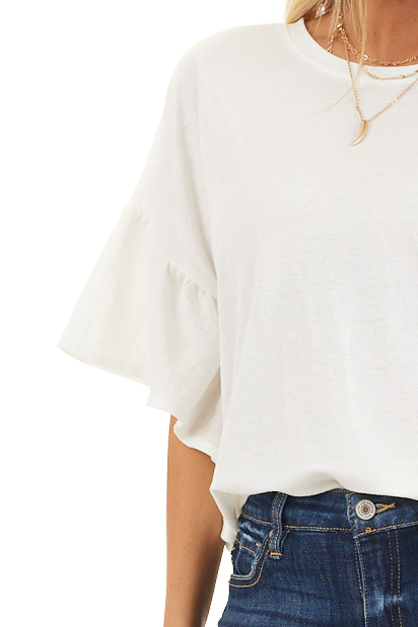 Off White Knit Top with Short Ruffled Sleeves detail