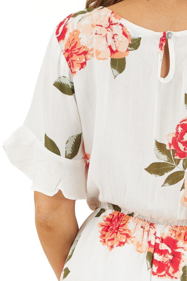 Off White and Salmon Floral Surplice Romper with Waist Tie detail