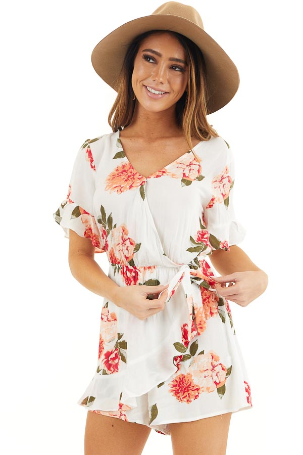 Off White and Salmon Floral Surplice Romper with Waist Tie front close up