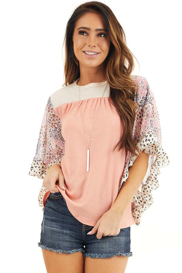 Coral and Cream Knit Top with Leopard Print Ruffle Sleeves front close up
