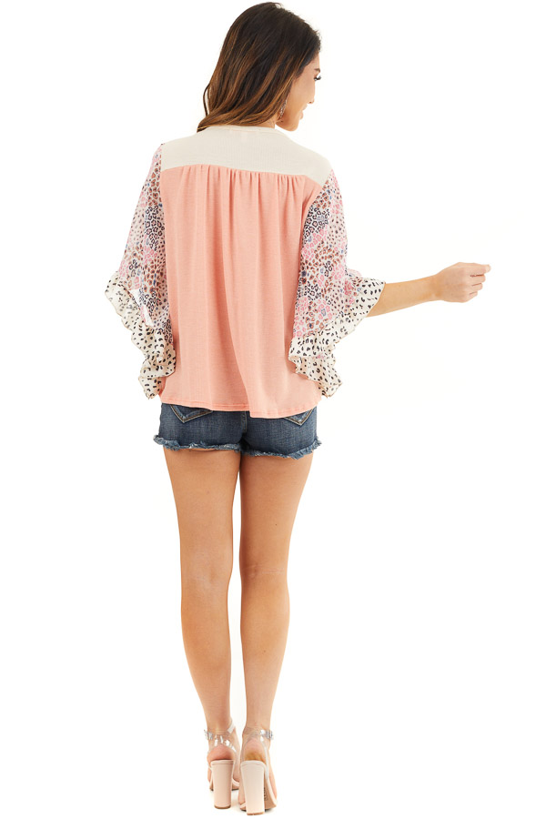Coral and Cream Knit Top with Leopard Print Ruffle Sleeves back full body