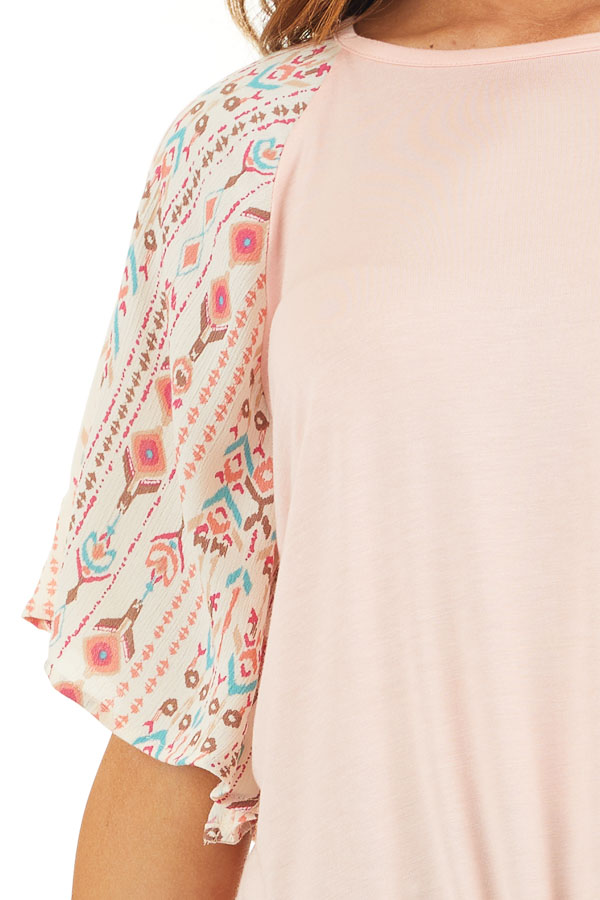 Peach Knit Top with Multicolor Sleeves and Front Tie detail