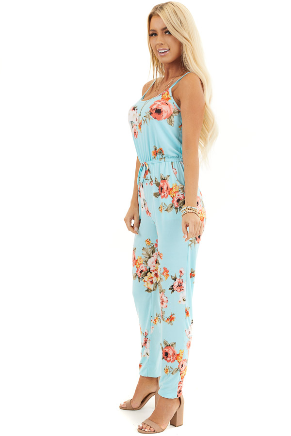 Turquoise Floral Sleeveless Jumpsuit with Cinched Waist side full body