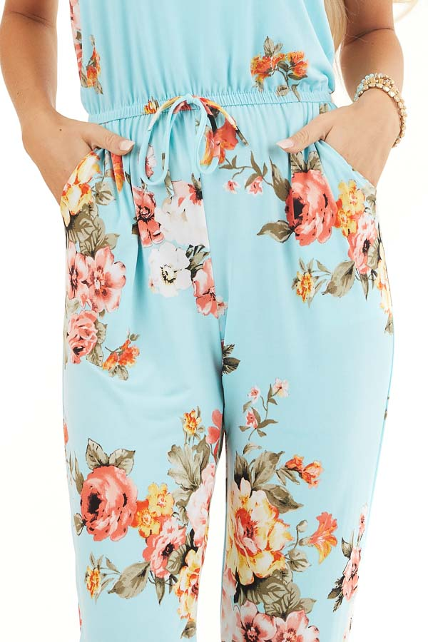 Turquoise Floral Sleeveless Jumpsuit with Cinched Waist detail