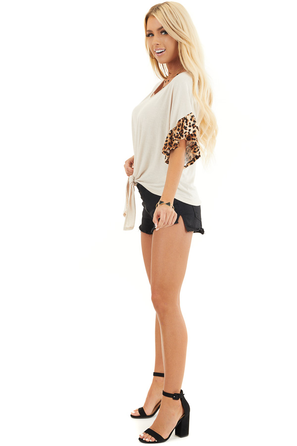 Ivory Front Knot Knit Top with Leopard Print Ruffle Sleeves side full body