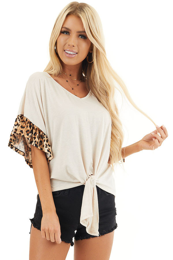 Ivory Front Knot Knit Top with Leopard Print Ruffle Sleeves front close up