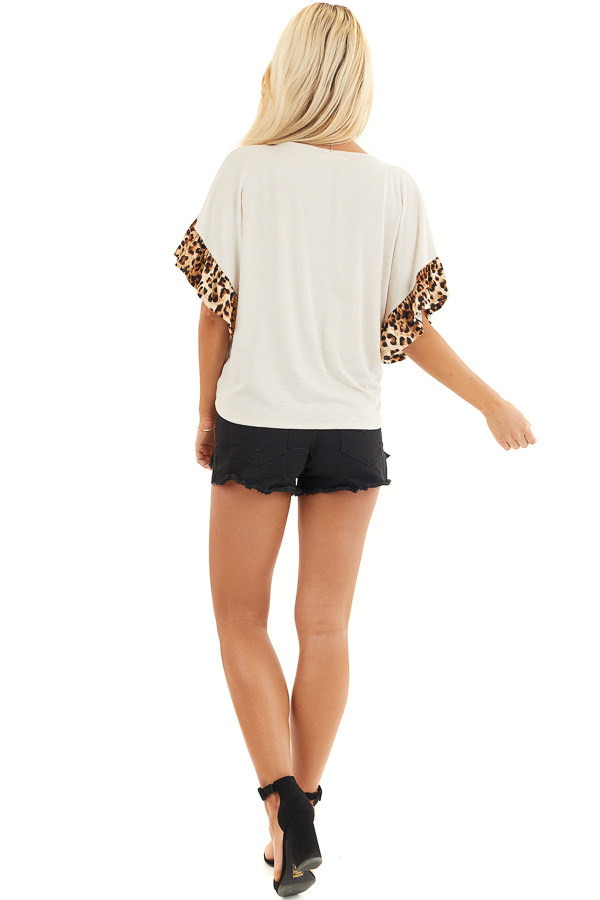 Ivory Front Knot Knit Top with Leopard Print Ruffle Sleeves back full body