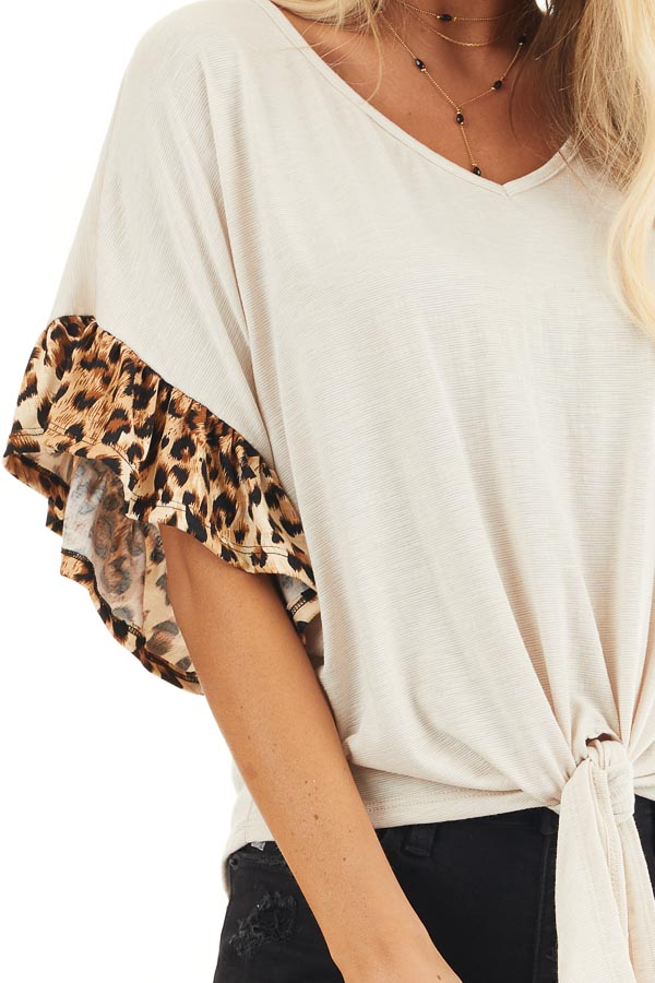 Ivory Front Knot Knit Top with Leopard Print Ruffle Sleeves detail