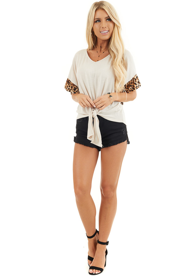 Ivory Front Knot Knit Top with Leopard Print Ruffle Sleeves front full body