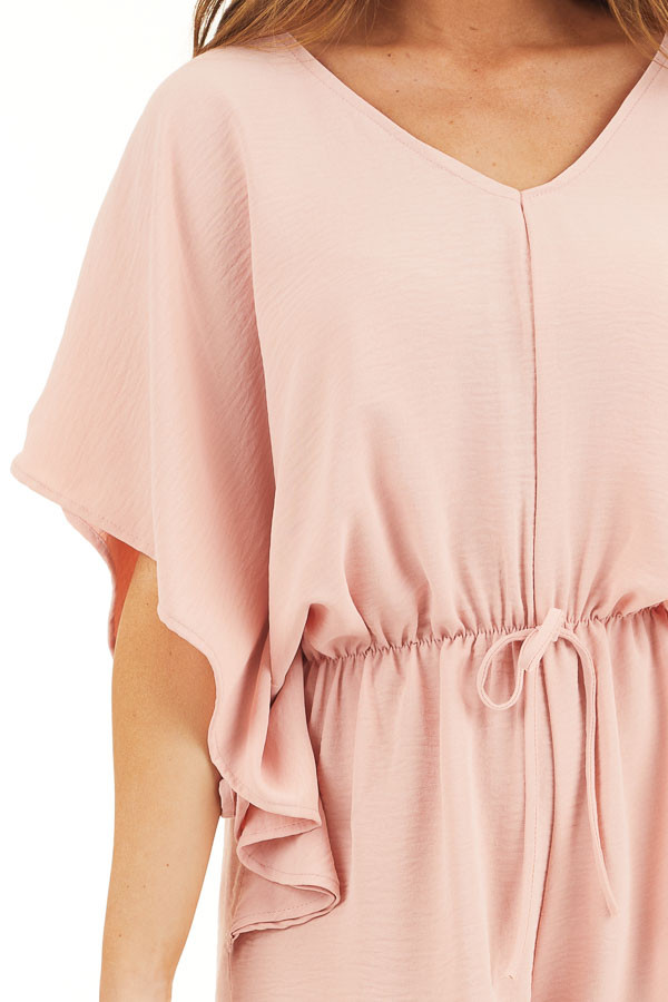 Dusty Blush Short Sleeve Romper with V Neck and Waist Tie detail