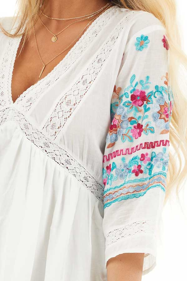 Off White Floral Embroidered Babydoll Dress with V Neckline detail