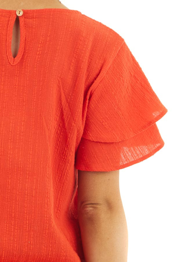 Tomato Red Textured Woven Top with Short Ruffled Sleeves detail