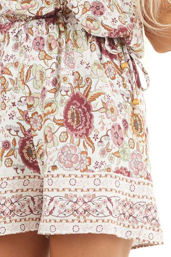 Dusty Rose Floral Spaghetti Strap Romper with Side Ties detail