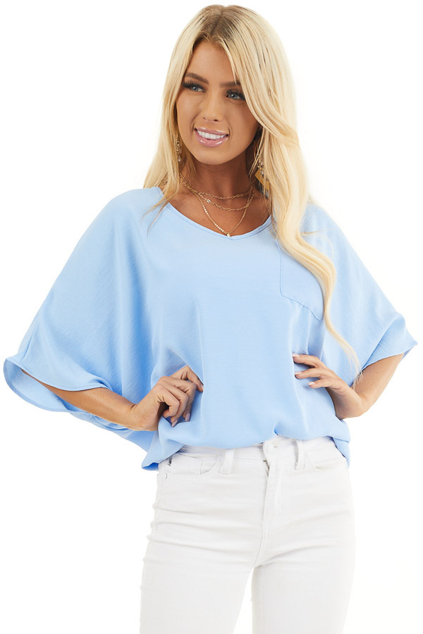 Powder Blue Oversized V Neck Top with High Low Hemline front close up