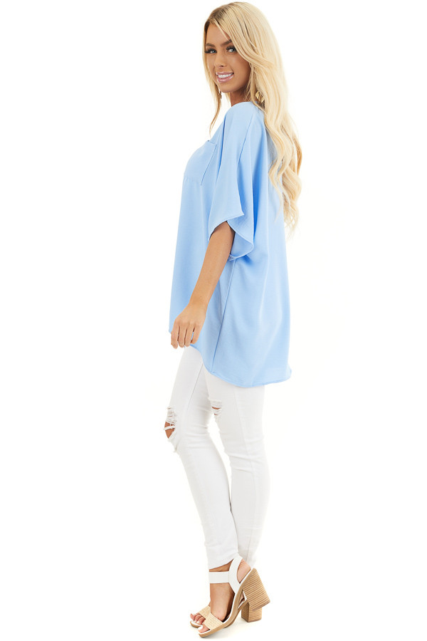 Powder Blue Oversized V Neck Top with High Low Hemline side full body