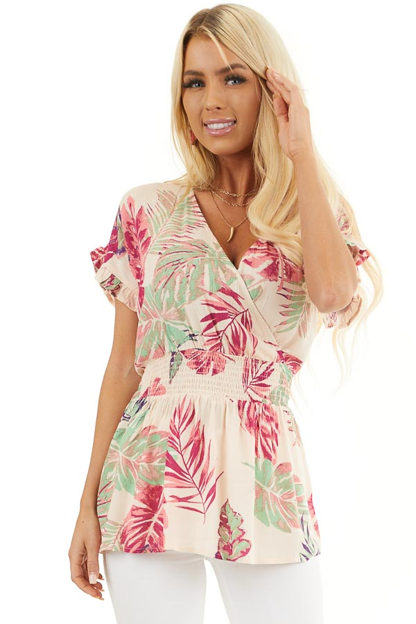 Pale Peach Tropical Print Surplice Top with Dropped Waist front close up