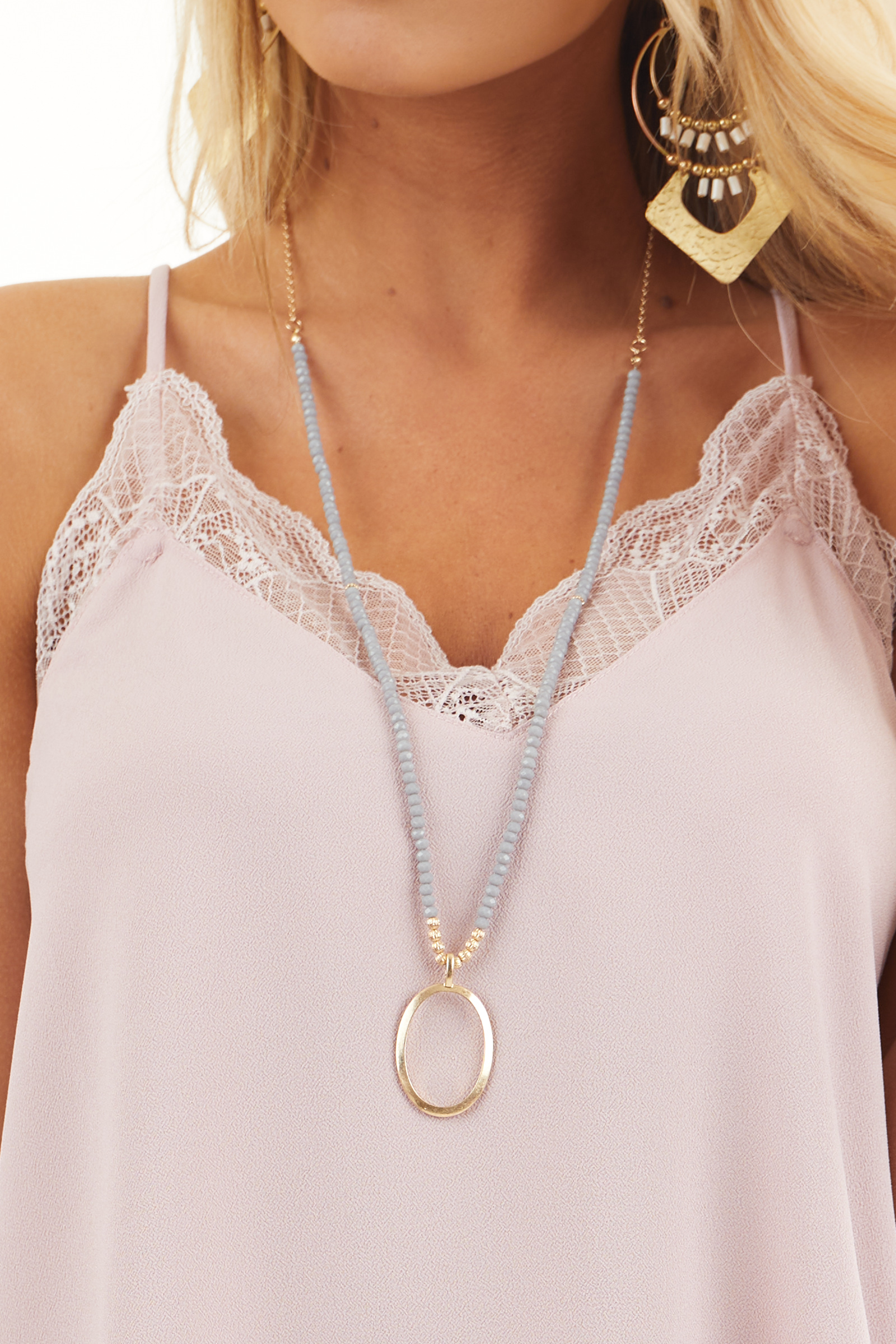 Gold Long Necklace with Grey Beads and Oval Pendant