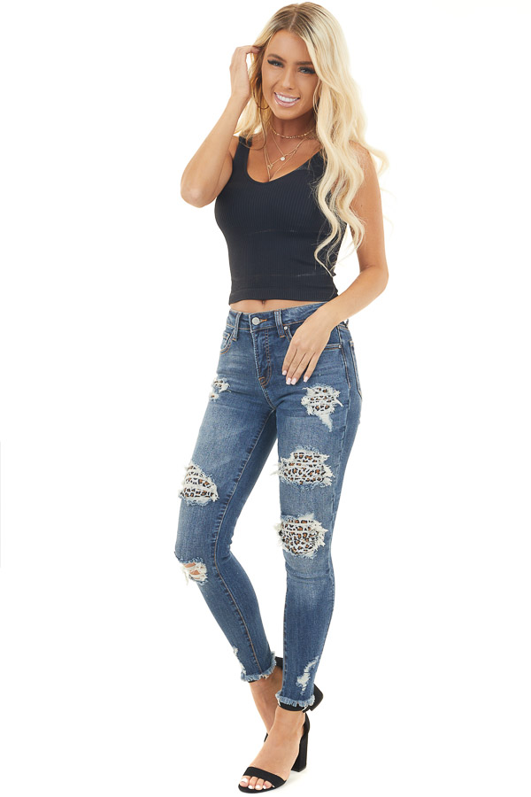 Dark Wash Denim Skinny Jeans with Distressed Leopard Print