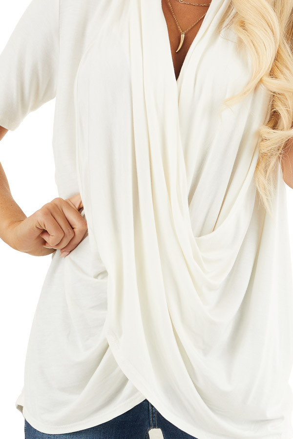 Ivory Super Soft Short Sleeve Knit Top with Drape Front detail