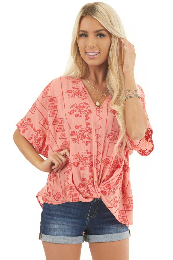 Coral Short Sleeve Embroidered Top with High Low Hemline front close up