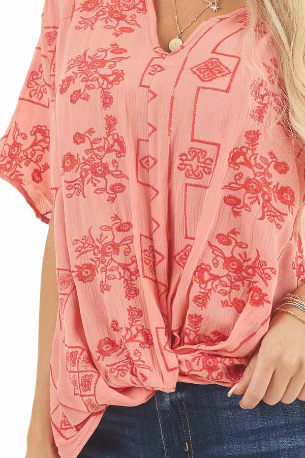 Coral Short Sleeve Embroidered Top with High Low Hemline detail
