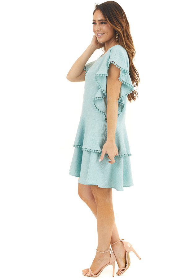 Mint Short Sleeve Mini Dress with Ruffle and Pom Pom Details side full body