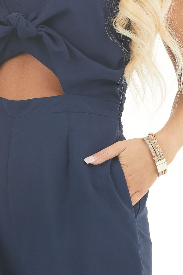 Navy Sleeveless Jumpsuit with Peek A Boo Chest and Tie detail