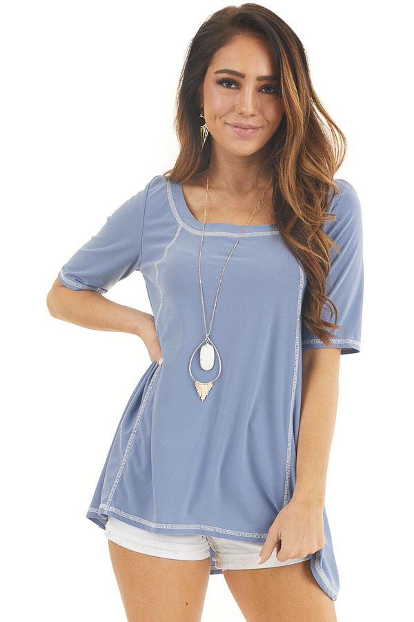 Dusty Blue Short Sleeve Top with Exposed Stitching Details front close up