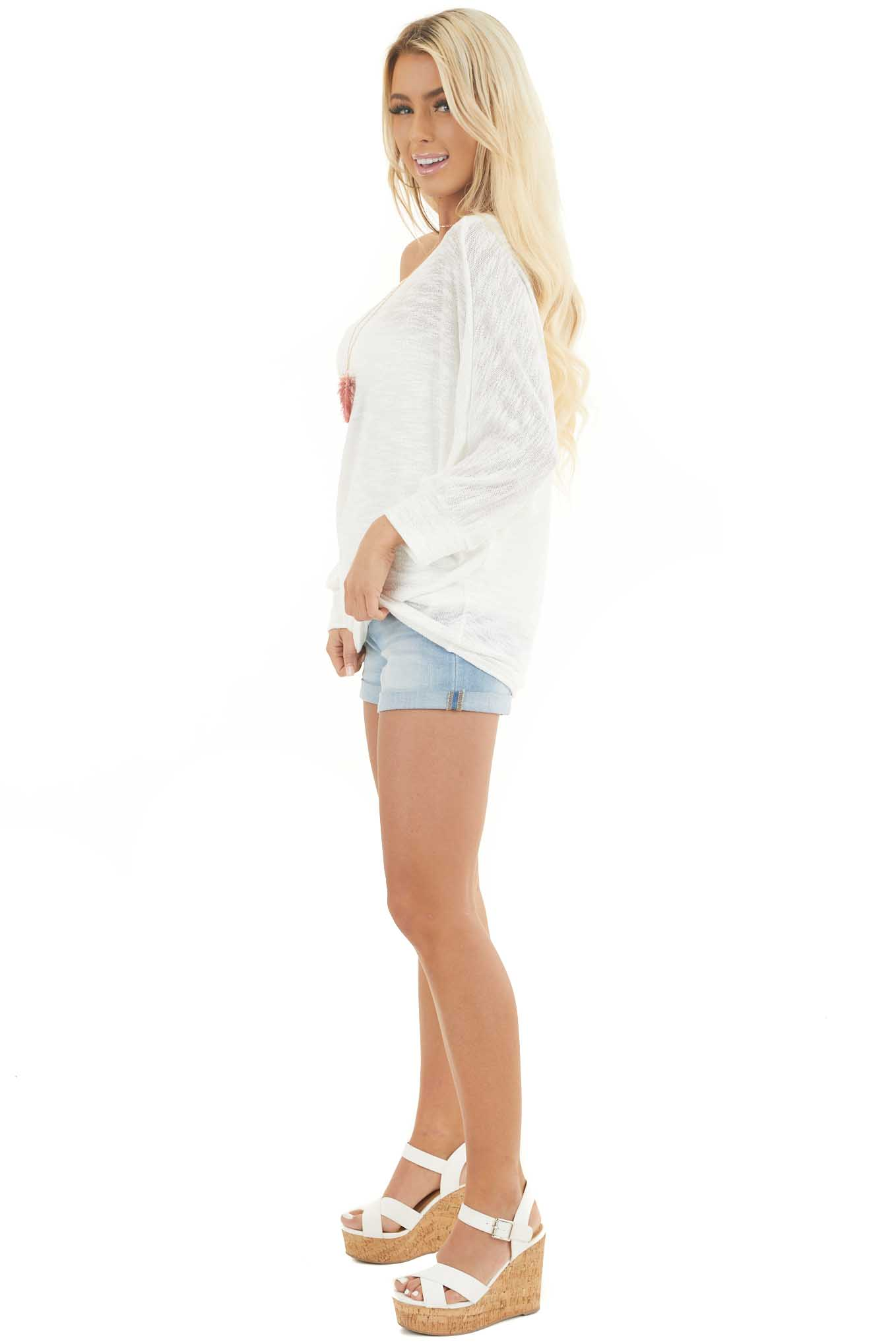 Off White Off the Shoulder Top with Long Dolman Sleeves side full body