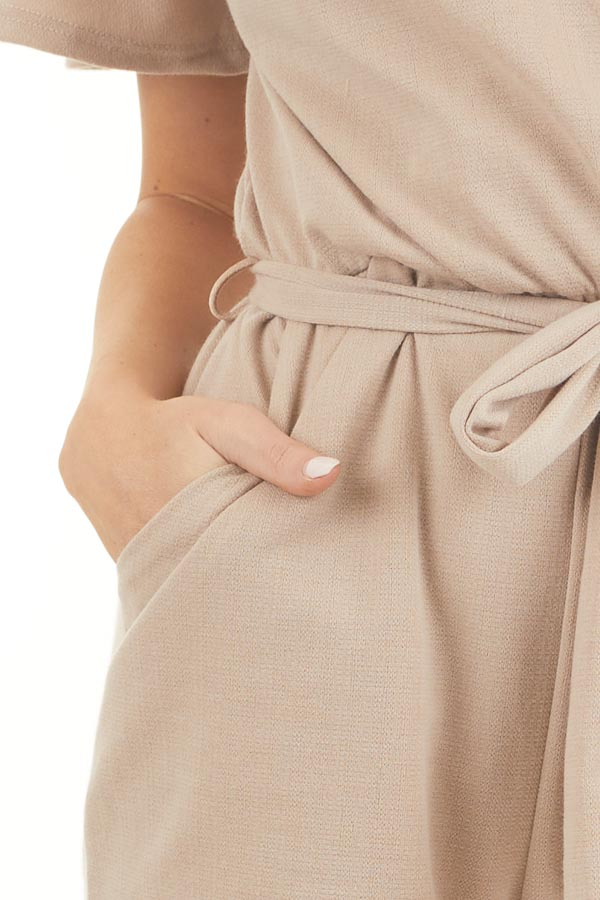 Latte Surplice Short Sleeve Romper with Waist Tie and Pockets detail