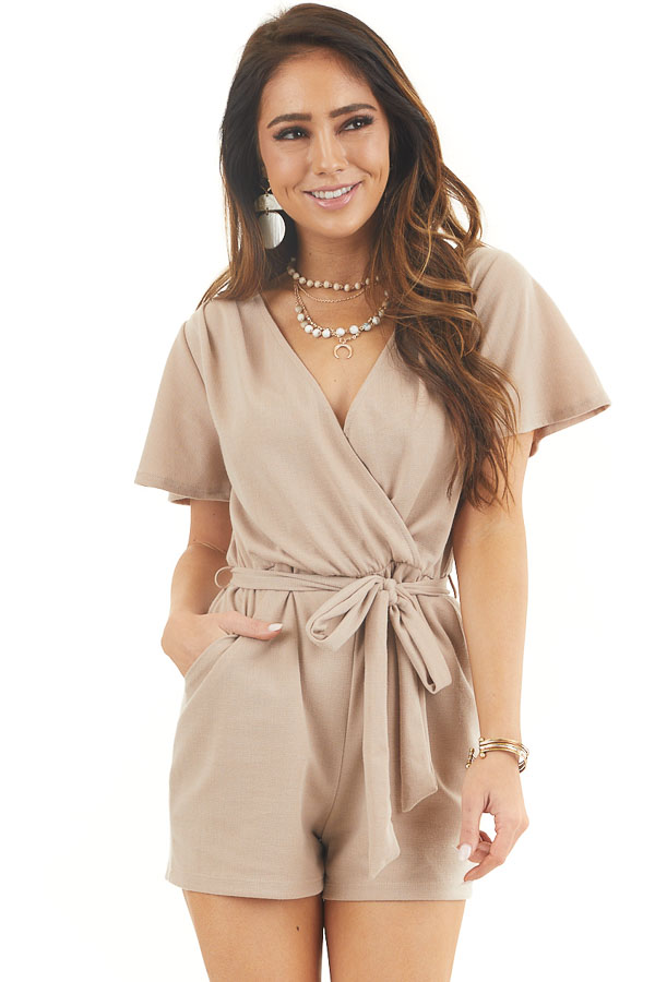 Latte Surplice Short Sleeve Romper with Waist Tie and Pockets front close up
