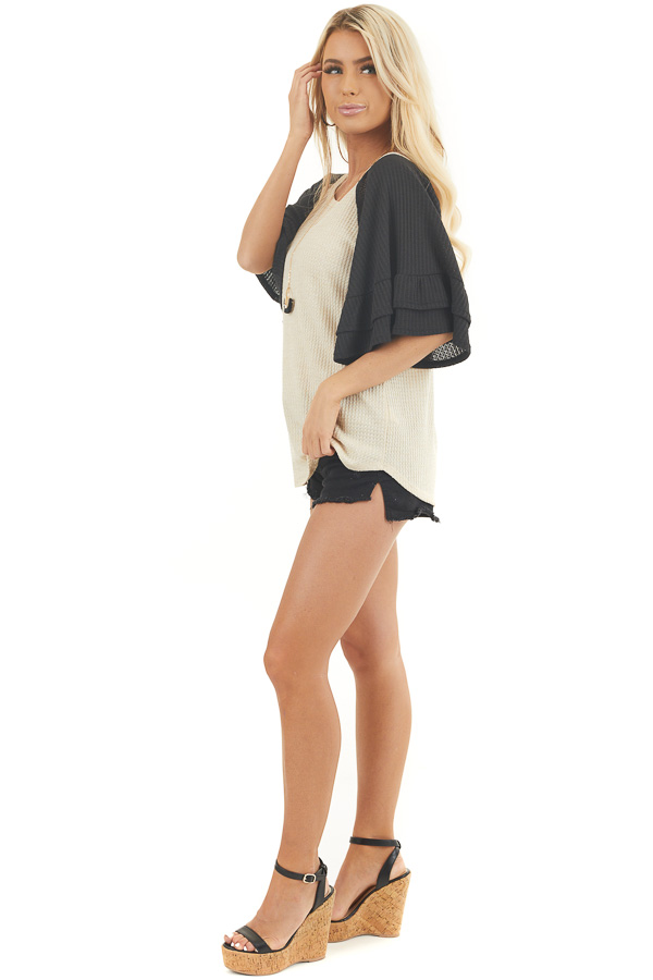 Beige and Black Waffle Knit Top with Ruffle Sleeves side full body