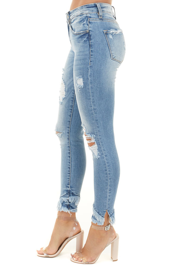 Medium Wash Distressed Mid Rise Skinny Jeans with Frayed Hem
