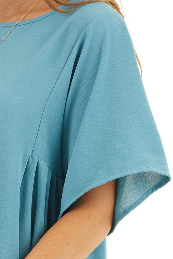 Dark Teal Loose Top with Rounded Neckline and Short Sleeves