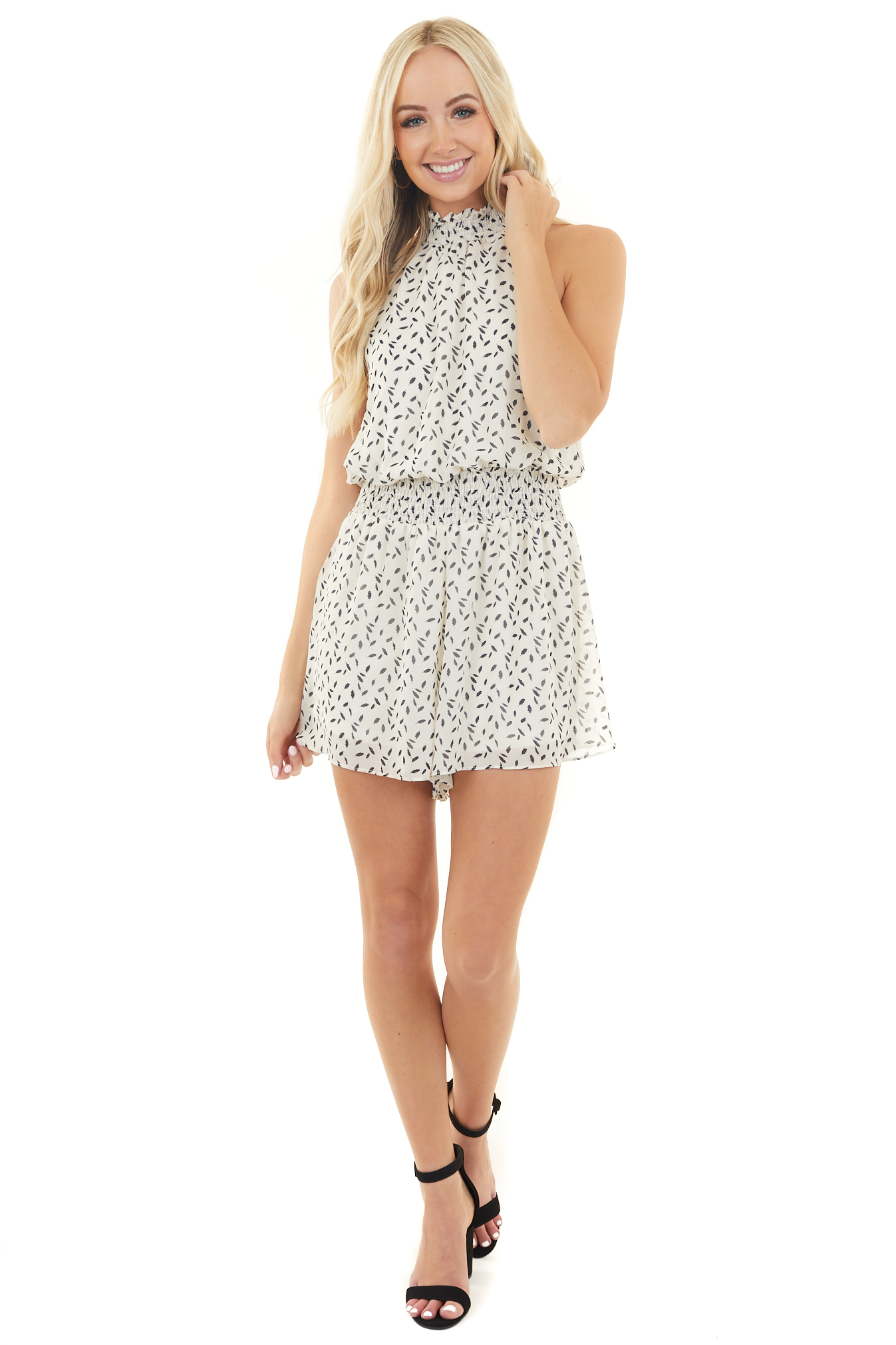 Cream Printed Halter Neck Romper with Keyhole Back Detail