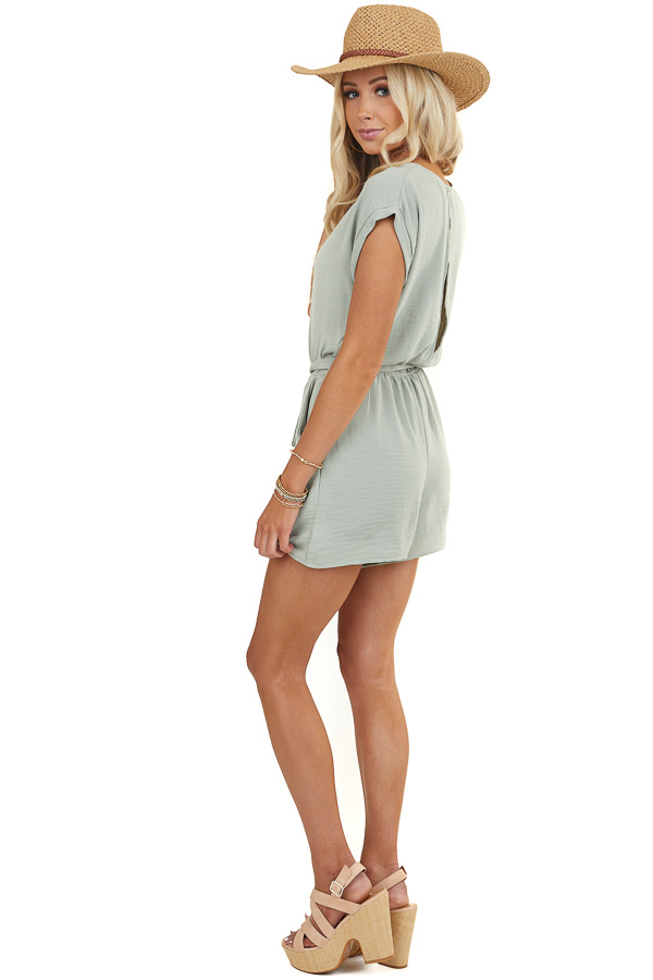 Sage Romper with Gold Front Zipper Detail and Waist Tie