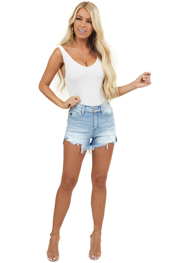 Medium Wash Denim Shorts with Raw Hem and Distressing Detail