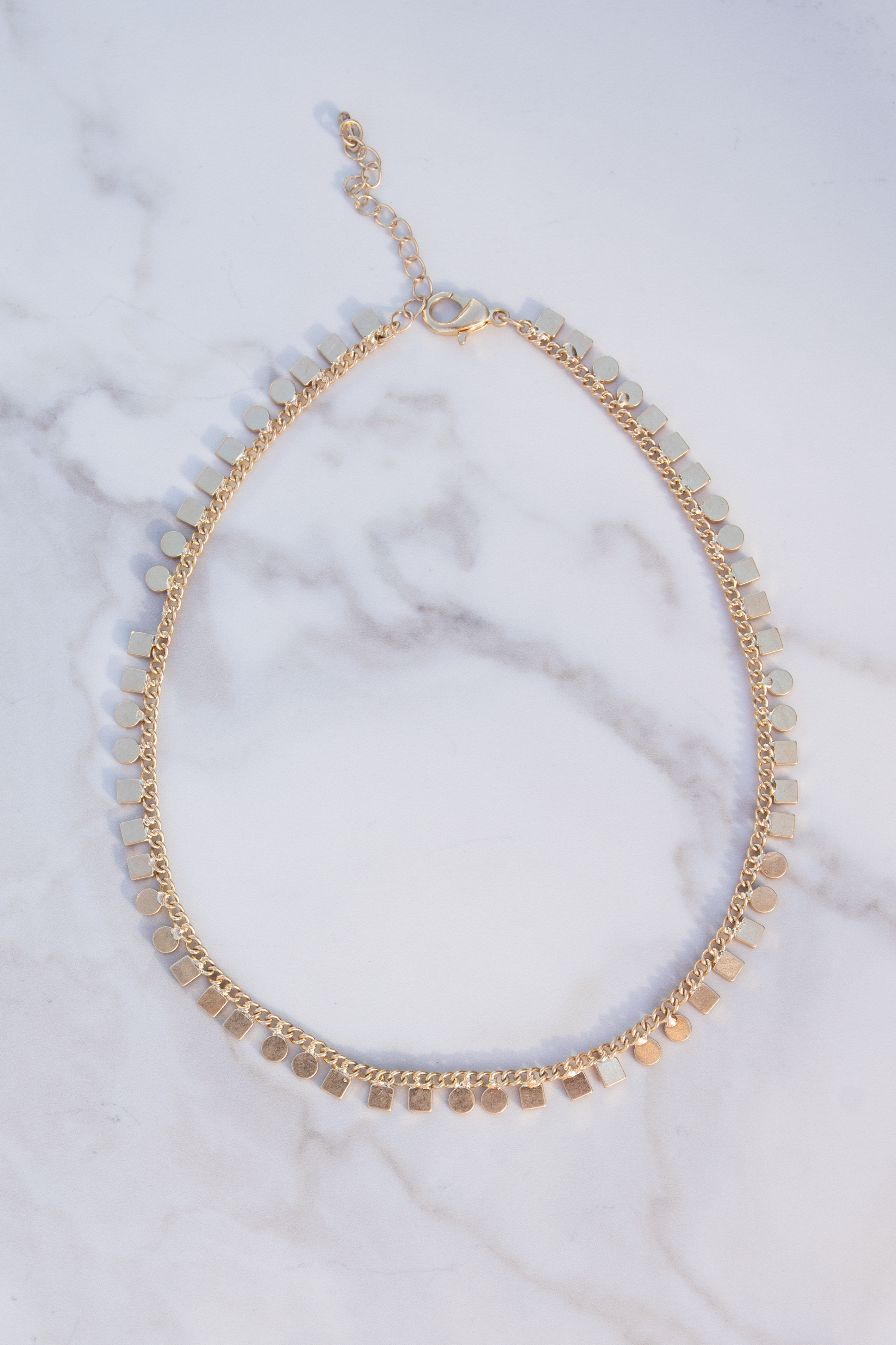 Brushed Gold Choker Necklace with Geometric Charms