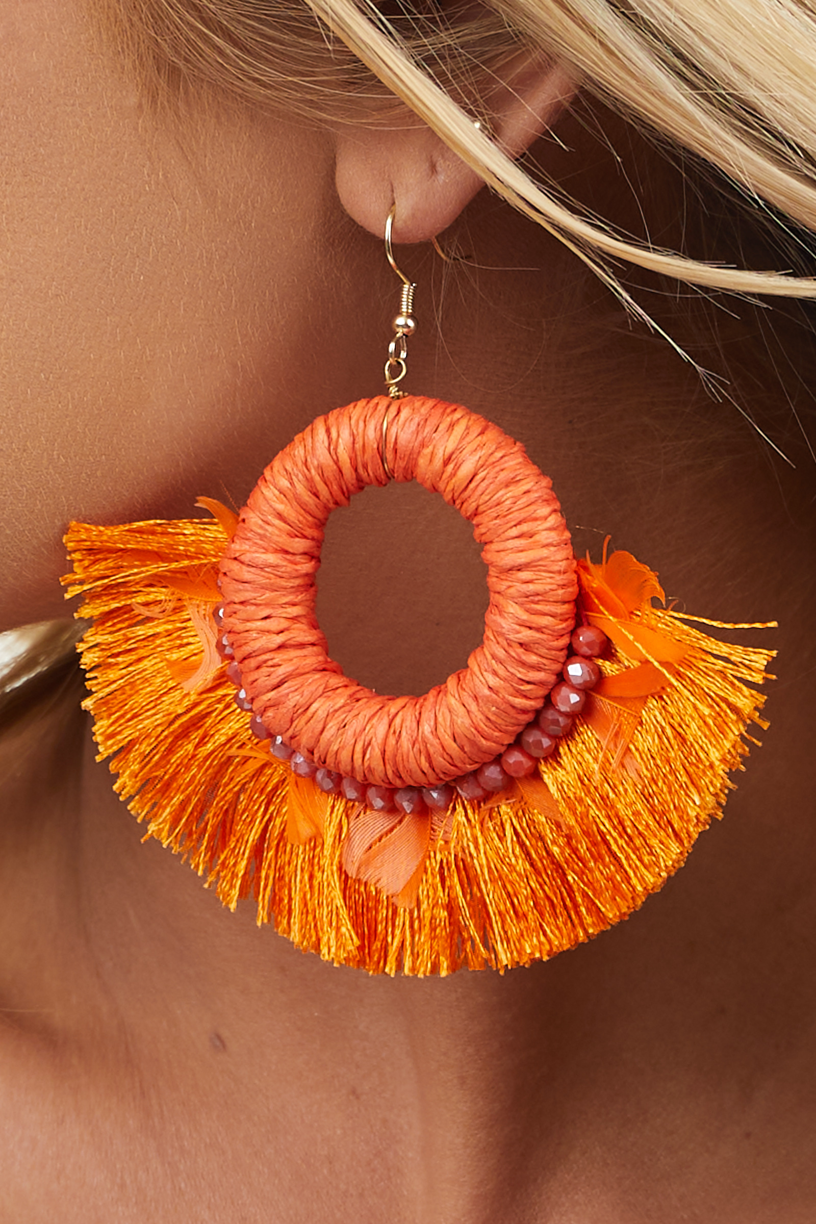 Bright Orange Hoop Earrings with Bead and Feather Details